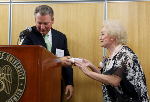 Dr. David Lefer, Director of the LSU Cardiovascular Center of Excellence, thanks Dr. Mary Lou Applewhite for her generosity.